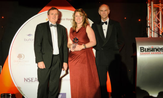Gemma Hughes receiving her award from Sir Ranulph Fiennes for Young Business Person of the year 2013
